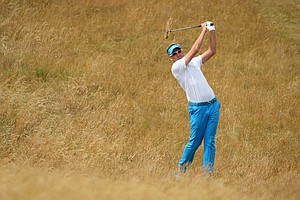 Ian Poulter hits a shot during a practice round on Tuesday at Muirfield.
