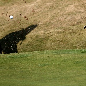 Rory McIlroy plays from a bunker on the 16th green during a practice round at Muirfield.