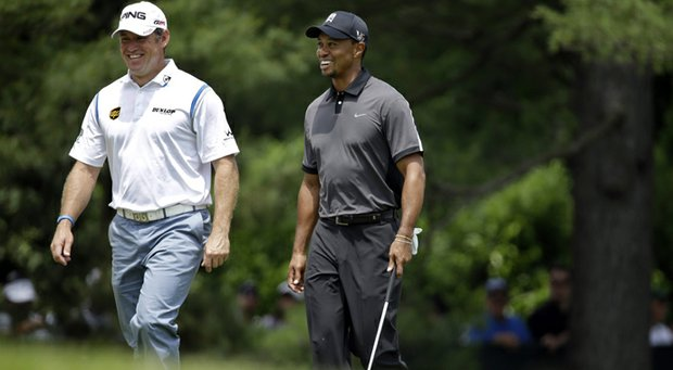 Lee Westwood (left) has joined Tiger Woods (right) as a client of coach Sean Foley.
