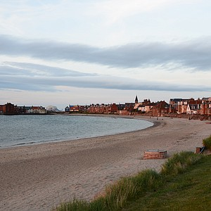 The North Berwick coastline at the sun is setting.