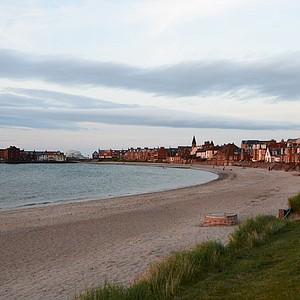 The North Berwick coastline at the sun is setting.