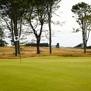 The par-3 15th hole at Renaissance Club is relatively close to Muirfield.  In the background you can see the stands for the Open Championship.