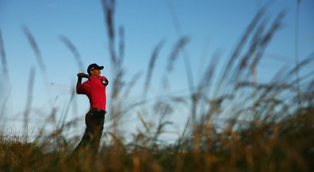 Tiger Woods hits a shot ahead of the Open Championship at Muirfield.