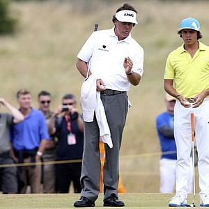 Phil Mickelson, left, and Rickie Fowler talk on the 15th green during a practice round Tuesday ahead of the Open Championship at Muirfield.