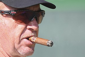 Miguel Angel Jimenez smokes a cigar during a practice round Tuesday ahead of the Open Championship at Muirfield.