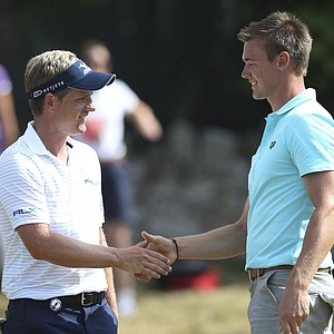 Luke Donald, left, shakes hands with Ben Stow after their practice round Tuesday ahead of the Open Championship at Muirfield.