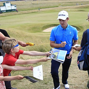 Justin Rose signs autographs for fans after a practice round Tuesday ahead of the Open Championship at Muirfield.