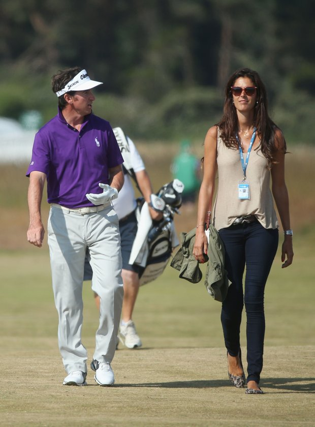 Gonzalo Fernandez-Castano and his wife Alicia walk along the fairway ahead of the Open Championship at Muirfield.