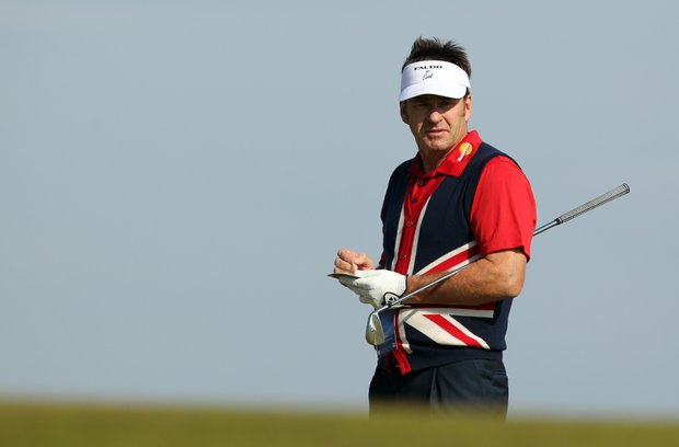 England's Nick Faldo looks at the 12th green during the last day of a practice session ahead of the 2013 Open Championship at Muirfield.