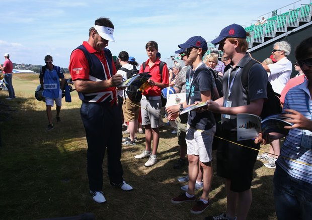 Sir Nick Faldo signs autographs ahead of the Open Championship at Muirfield.
