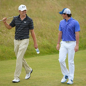 Rory McIlroy and Jordan Spieth walk along the fairway ahead of the 142nd Open Championship at Muirfield.
