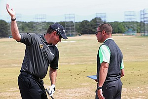 Lee Westwood talks with coach Sean Foley ahead of the 142nd Open Championship at Muirfield.
