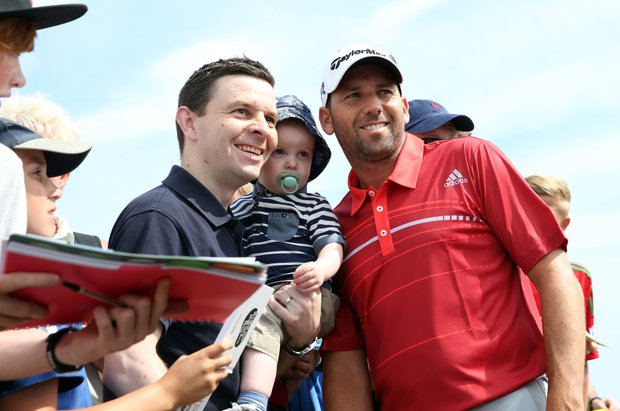 Sergio Garcia poses for a picture with fans during the last day of practice ahead of the 2013 Open Championship at Muirfield.