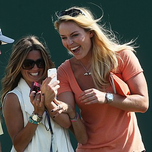 Nadine Moze and skier Lindsey Vonn laugh ahead of the Open Championship at Muirfield.