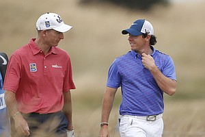 Jim Furyk (left) and Rory McIlroy during Wednesday practice for the 2013 British Open at Muirfield.