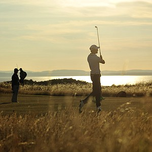 Gregory Bourdy plays a shot on the 17th fairway during the first round of the 2013 Open Championship at Muirfield.
