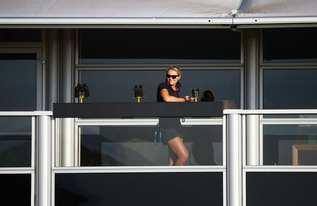 Lindsey Vonn watches the golf during the first round of the 142nd Open Championship at Muirfield.