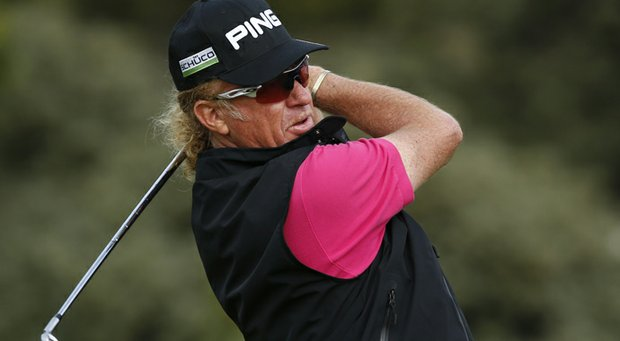 Miguel Angel Jimenez plays a shot off the third tee during the first round of the Open Championship at Muirfield.