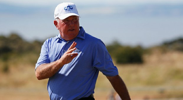 Mark O'Meara waves after a putt for par on 16 during the first round of the 142nd Open Championship at Muirfield.