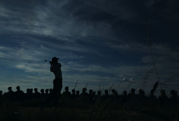 Tiger Woods tees off on the 17th during the first round of the 142nd Open Championship at Muirfield.