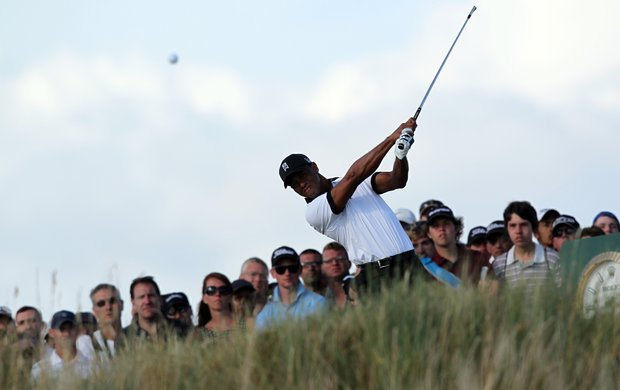 Tiger Woods prepares to tee off on the 15th during the first round of the 2013 Open Championship at Muirfield.