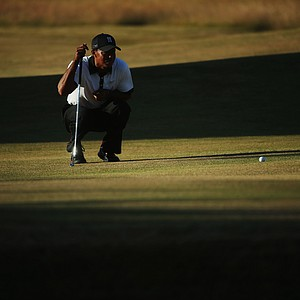 Tiger Woods prepares to putt on the 18th green during the first round of the 142nd Open Championship at Muirfield.