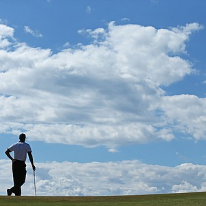 Tiger Woods looks on from the 4th green during the first round of the 142nd Open Championship at Muirfield.