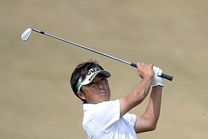Makoto Inoue hits his 2nd shot on the sixth hole during the first round of the Open Championship at Muirfield.