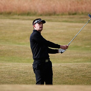 Garrick Porteous, the 2013 British Amateur champion, hits his second shot on the 2nd hole during the first round of the Open Championship.