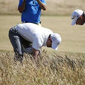 Sergio Garcia and Charl Schwartzel during the first round of the 2013 Open Championship at Muirfield.