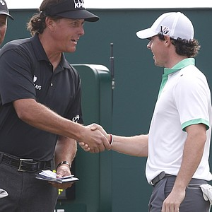 Phil Mickelson and Rory McIlroy during the first round of the 2013 Open Championship at Muirfield.