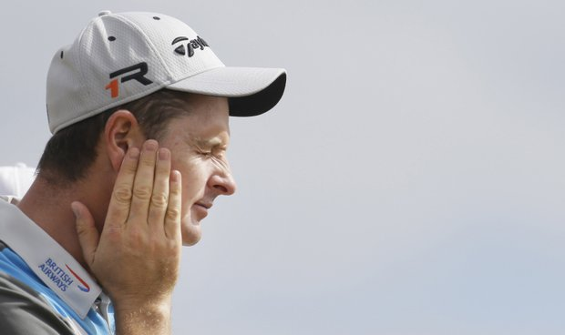 Justin Rose applies sunscreen during the first round of the 2013 Open Championship at Muirfield.