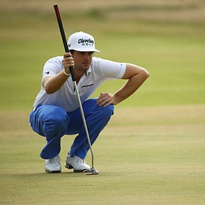 Keegan Bradley lines up a putt on the 1st green during the first round of the Open Championship at Muirfield in Gullane, Scotland.