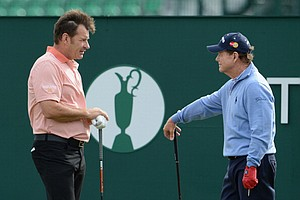 Sir Nick Faldo chats to Tom Watson on the 1st tee during the first round of the Open Championship at Muirfield.