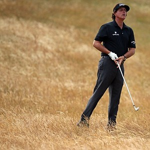 Phil Mickelson plays out of the 11th rough during the first round of the 2013 Open Championship at Muirfield.