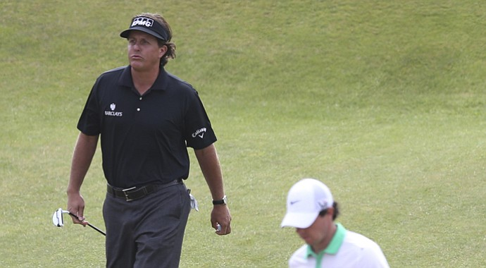 Phil Mickelson (left) and Rory McIlroy during the first round of the 2013 British Open at Muirfield.