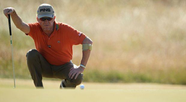 Miguel Angel Jimenez lines up a putt during the second round of the 142nd Open Championship at Muirfield.
