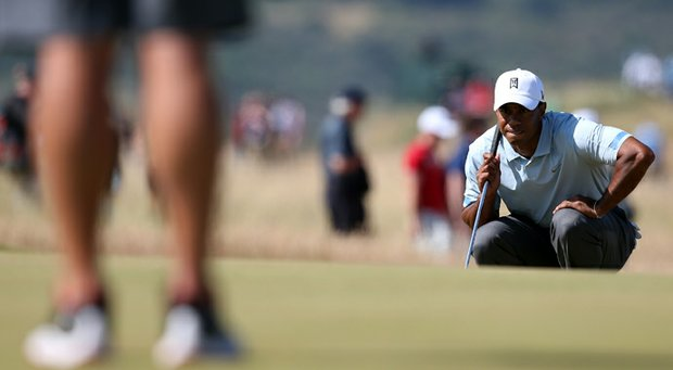 Tiger Woods did his work on the greens on Friday, saving par at 10 (13 feet), 13 (9 feet), 14 (60-foot pitch stiff) and 15 (4 feet).