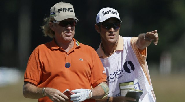 Miguel Angel Jimenez and his caddie during the 2013 British Open at Muirfield.