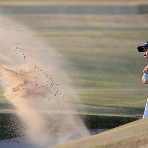Camilo Villegas hits from a bunker on the ninth hole during the second round of the Open Championship.