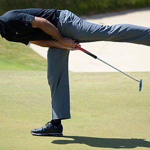 Charl Schwartzel reacts to a putt on the 18th green during the second round of the 142nd Open Championship at Muirfield.