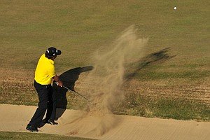 Jason Dufner plays a shot out of a bunker on the 18th during the second round of the 2013 Open Championship