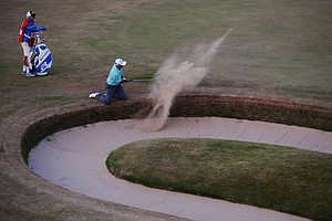 Jimmy Mullen hits out of a bunker on the 18th during the second round of the 142nd Open Championship at Muirfield.