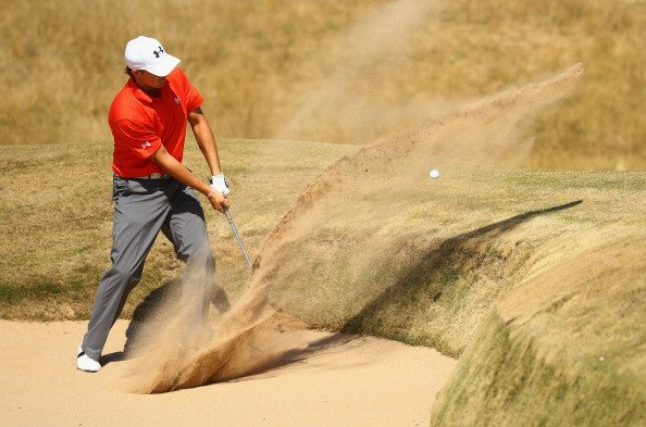 Jordan Spieth plays out of a bunker on the 16th hole during the second round the Open in Scotland.