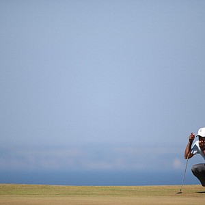 Tiger Woods lines up a putt on the 11th green during the second round of the 2013 Open Championship.