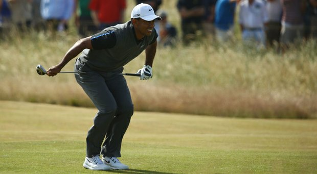 Tiger Woods reacts on the 5th fairway during the third round of the 142nd Open Championship at Muirfield.