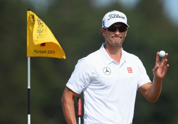 Adam Scott reacts after he putts on the seventh during the third round of the 142nd Open Championship.