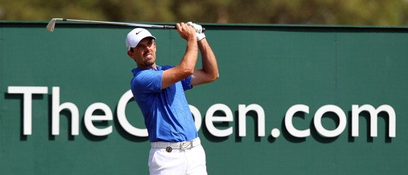 Charl Schwartzel tees off on the first during the third round of the 2013 Open Championship.