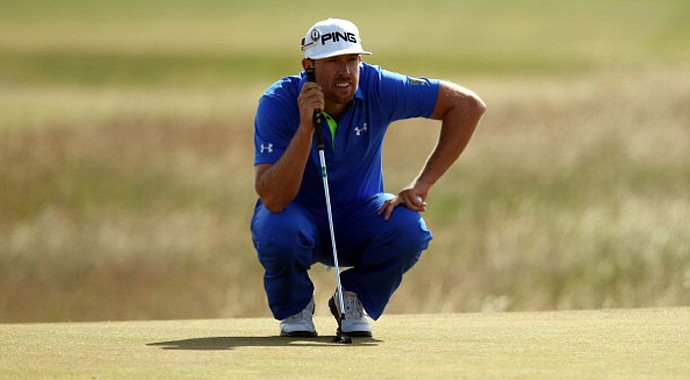 Hunter Mahan lines up a putt on the 13th green during the third round of the 2013 Open Championship at Muirfield in Gullane, Scotland