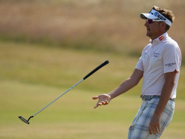 Ian Poulter reacts to a putt during the third round of the Open Championship at Muirfield.